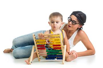 mother and kid boy play with counter toy