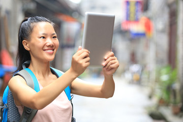 woman tourist use digital tablet outdoor