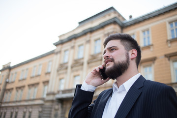 Modern young businessman on the phone