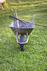Wheelbarrow with rake on top