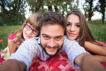 Happy young family taking selfies