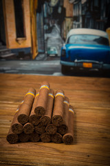 cigars on rustic table