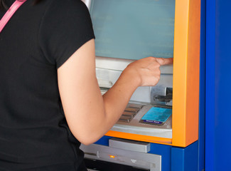 Women pressing ATM machine