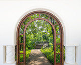 open door arch with access to the alley - 69769140