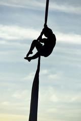 woman acrobatic dancer on aerial silk, aerial contortion