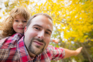 Happy father and child in autumn