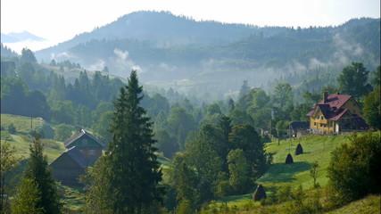 House in the foggy mountains. Carpathian, Ukraine. Timelapse