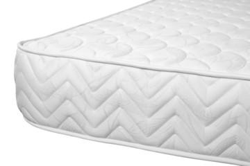 Orthopedic mattress against white background.