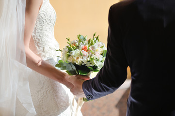 In the hands of the bride and groom wedding bouquet