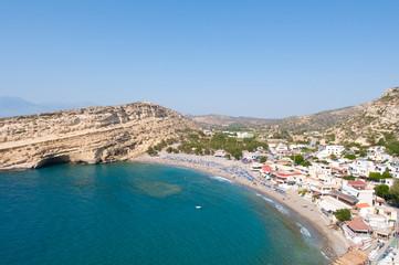 Matala sandy beach with caves near Heraklion town. Crete, Greece