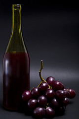 Bottle of wine with grapes