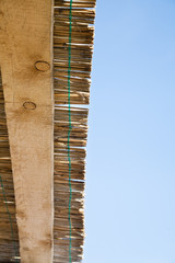traditional reed and wooden roof with blue sky
