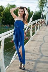 Beautiful young oriental girl on bridge over river