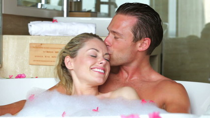 Couple Relaxing In Bath Together