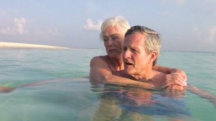 Senior Couple Relaxing In Tropical Sea