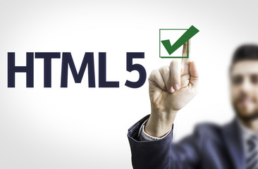 Business man pointing the text: HTML 5