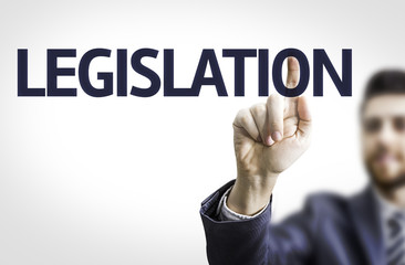 Business man pointing the text: Legislation