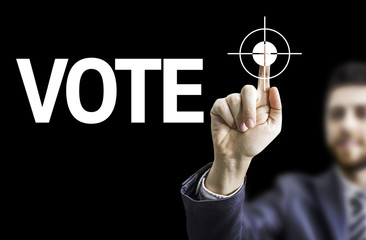 Business man pointing the text: Vote