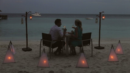 Couple Enjoying Late Meal In Outdoor Restaurant