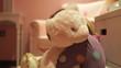 Girl Giving Teddy Bear Hug Whilst Wearing Pajamas