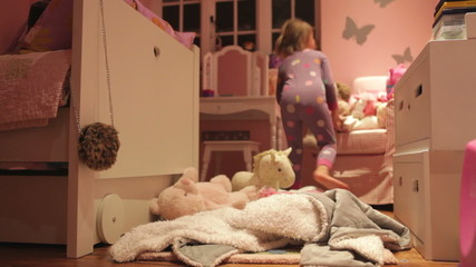 Time-Lapse Sequence Of Girl Playing With Toys In Bedroom