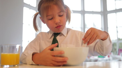 Girl Wearing School Uniform Eating Breakfast Cereal