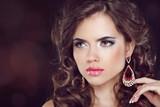 Fototapety Beautiful fashion woman model with wavy long hair and fashion ea