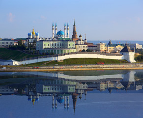 kazan kremlin with reflection in river at sunset