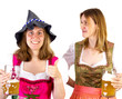 Girl in dirndl wearing Seppelhut showing thumb up