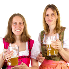 Women in dirndl presenting double beer