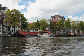 City channel and embankment. Amsterdam, Holland
