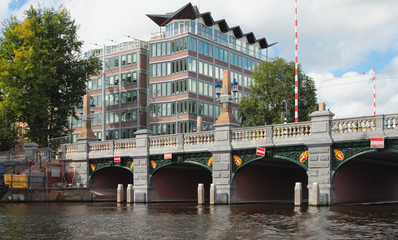 Building and bridge via channel. Amsterdam, Holland