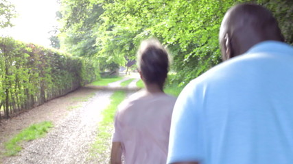 Mature African American Couple Running Along Country Path