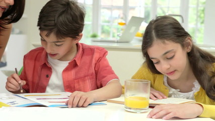 Mother Helping Children With Homework