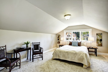 Bedroom interior with vaulted ceiling and sitting area