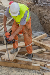 bulder worrkers cutting wooden board 4