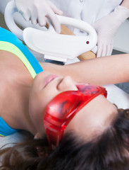 Woman getting laser treatment, permanent hair removal concept