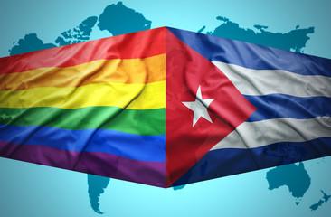 Waving Cuban and Gay flags