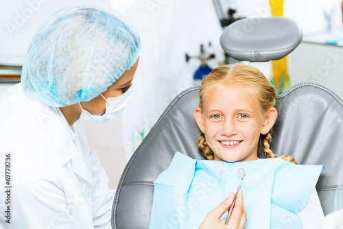 Dentist inspecting patient