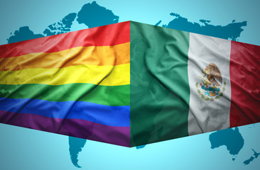 Waving Mexican and Gay flags