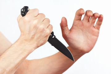 Hand position for defense with a army knife on white background