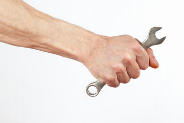 Hand of worker with a wrench closeup