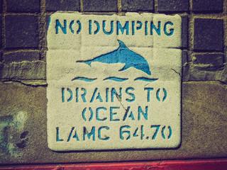 Retro look No dumping drains sign