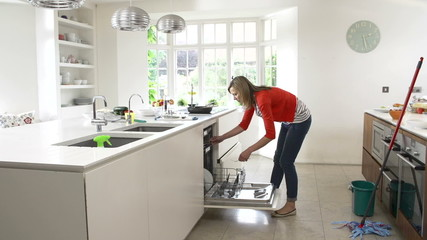 Time Lapse Sequence Of Busy Woman Working In Kitchen