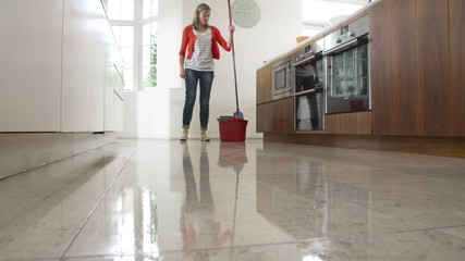 Time Lapse Sequence Of Woman Mopping Kitchen Floor