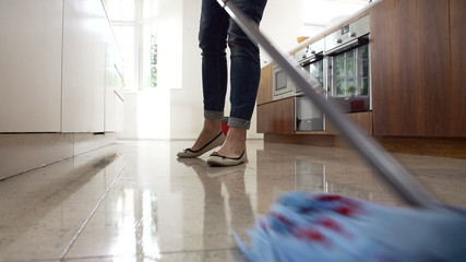 Slow Motion Sequence Of Woman Mopping Kitchen Floor