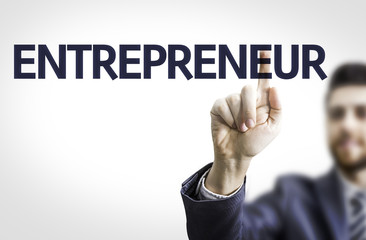Business man pointing the text: Entrepreneur