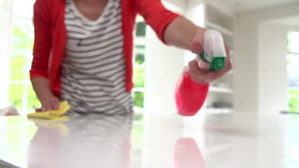 Slow Motion Sequence Of Woman Cleaning Surface In Kitchen