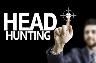 Business man pointing the text: Head Hunting