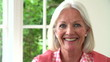 Slow Motion Sequence Of Middle Aged Woman Smiling At Camera